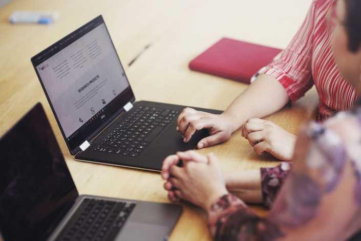 People workign together over a laptop