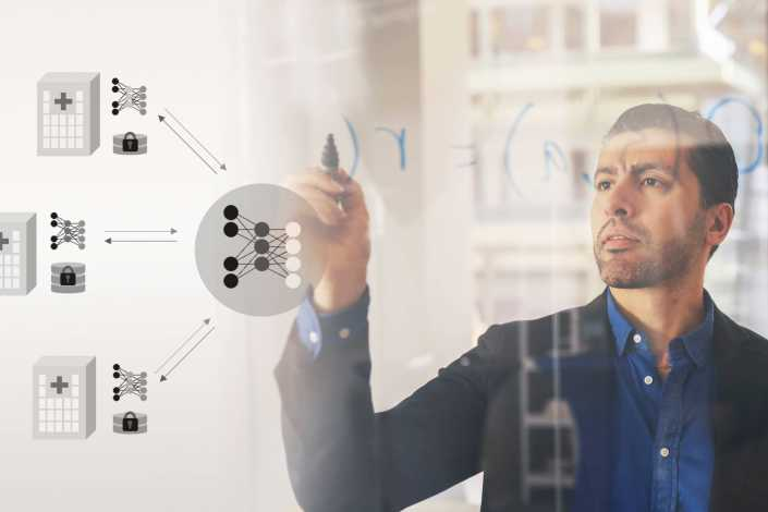 Man sketching on a whiteboard, visualization of decentralization of AI