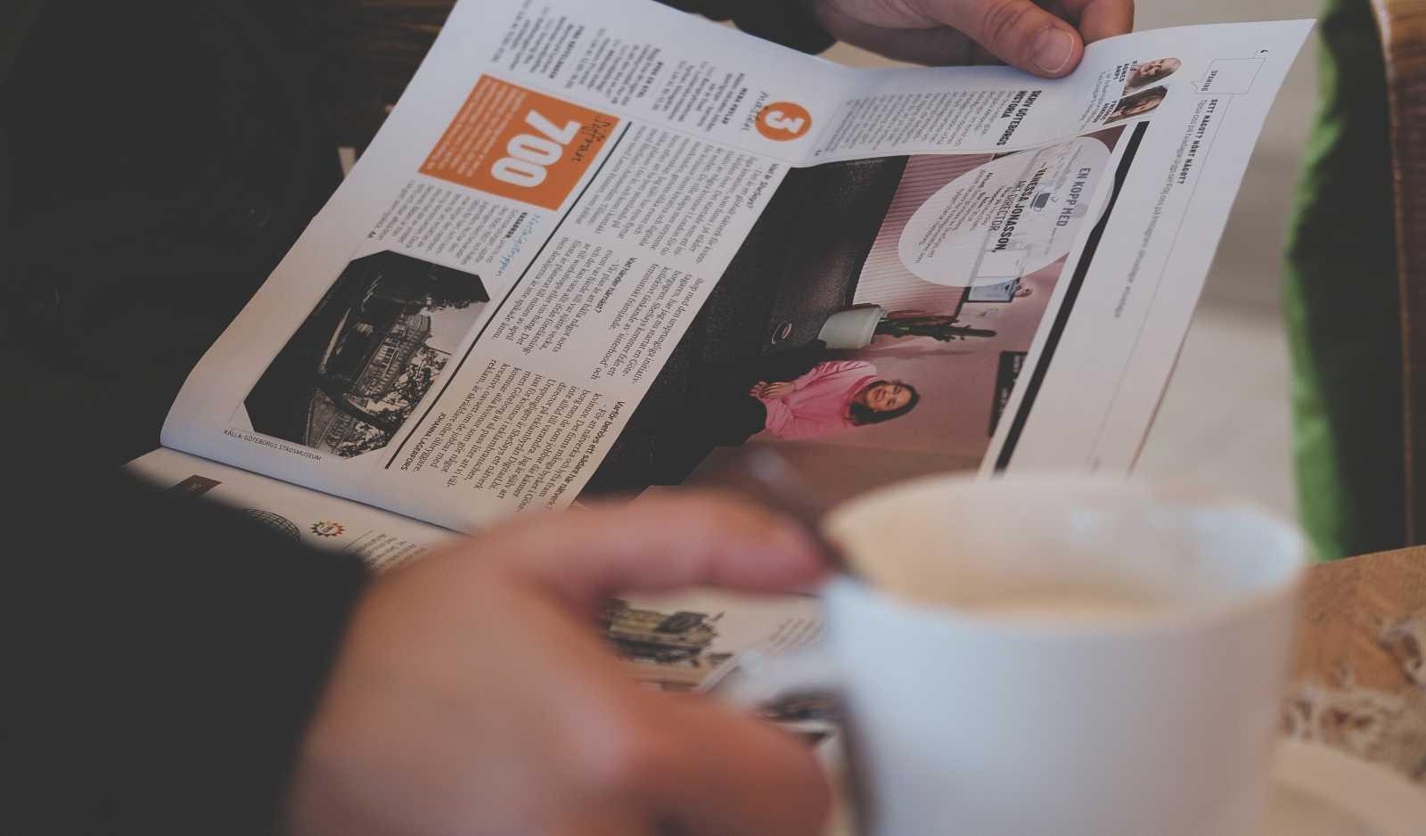 Coffee and Swedish Newspaper